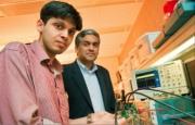 PhD student Saurav Bandyopadhyay, left, and Professor Anantha Chandrakasan showing the designed system. Photo: Justin Knight/MIT Energy Initiative